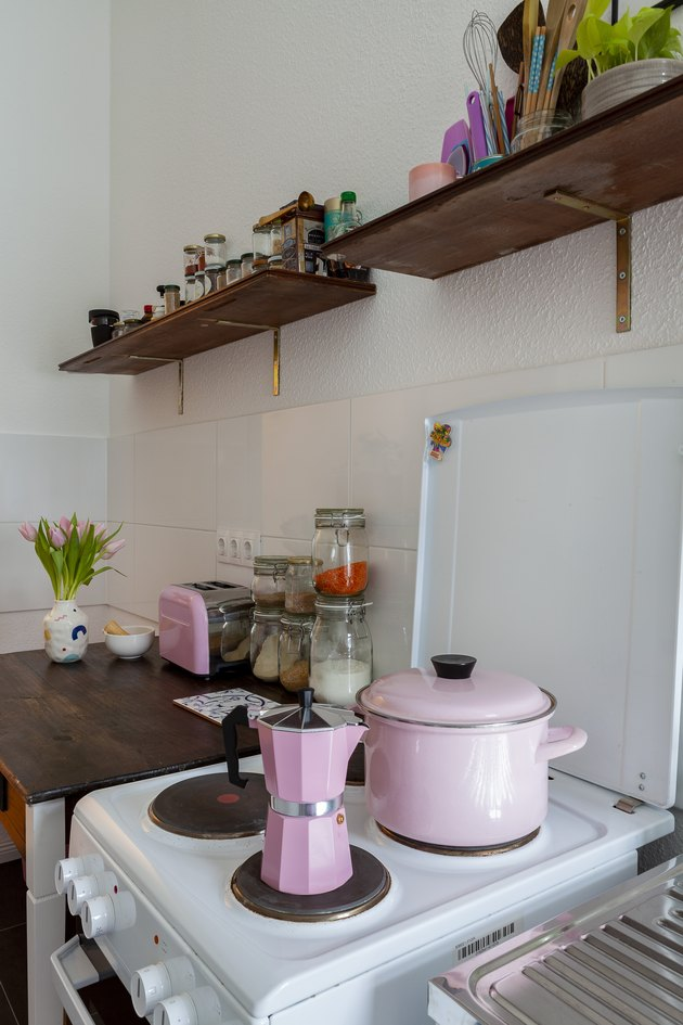 Pops of pink and a converted desk in the kitchen.