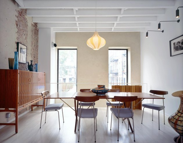 dining area with pendant lamp and modern wall sconces