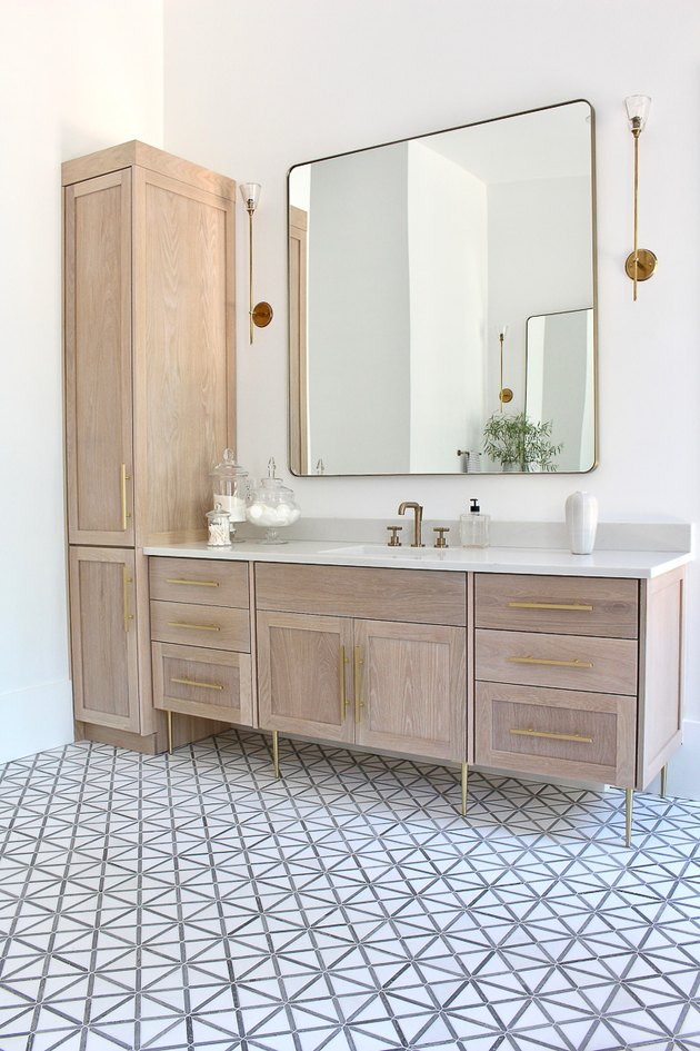 bathroom mirror idea with huge accent mirror in neutral bathroom
