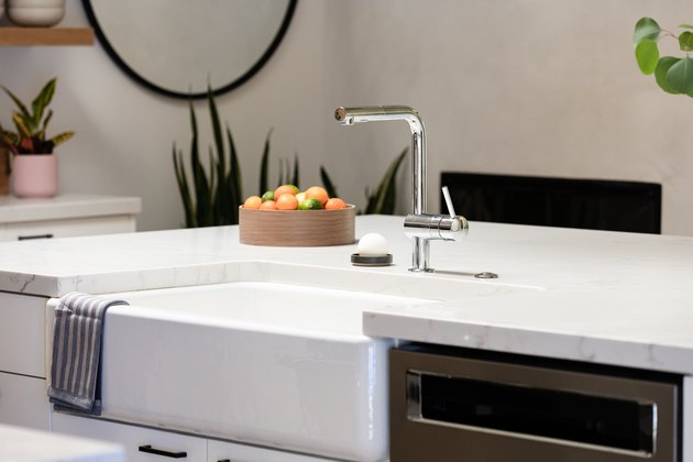 single-handle kitchen faucet and farmhouse sink in kitchen island