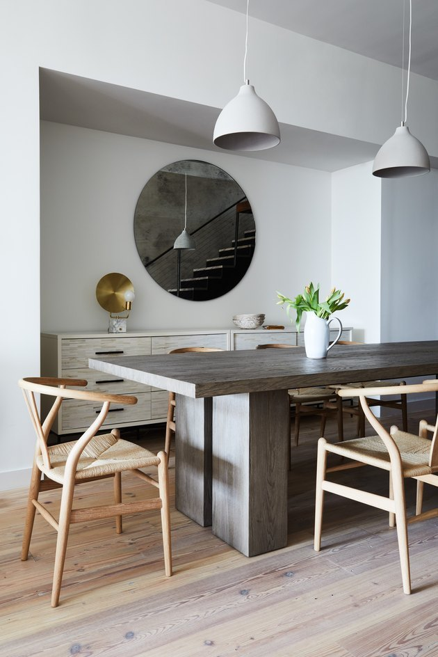 dining table with pendant lights and wishbone chairs