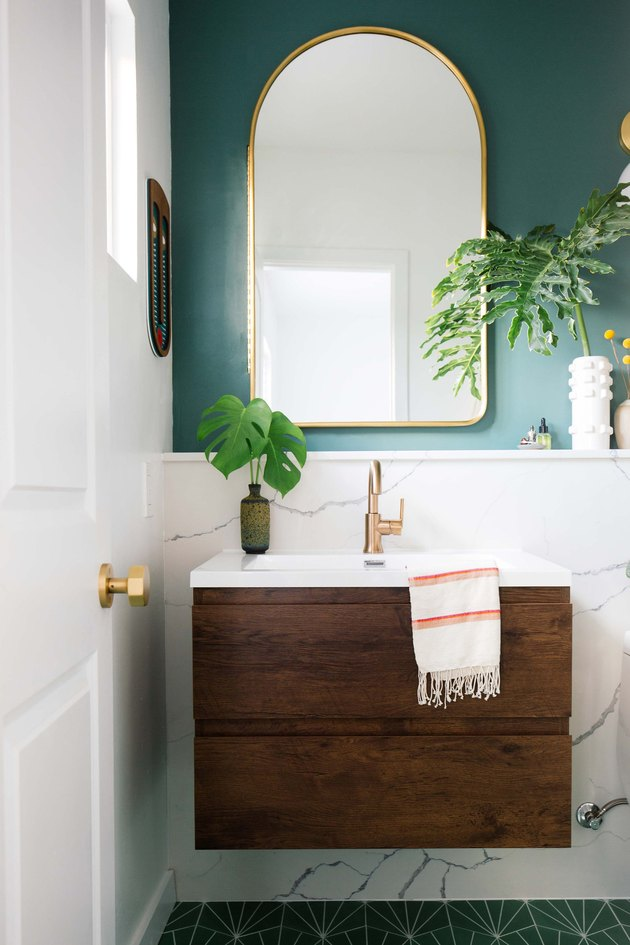 bathroom mirror idea with green and marble bathroom with wooden vanity and gold arch mirror