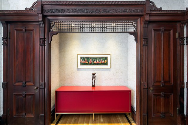 historic wooden design details and modern red sideboard