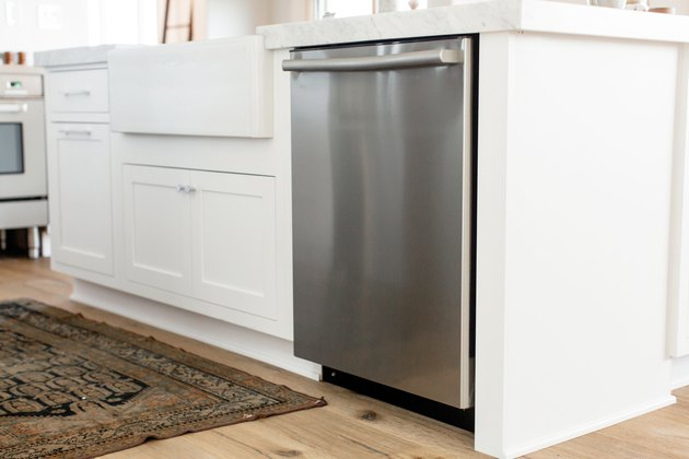 diswasher installed in a white kitchen island