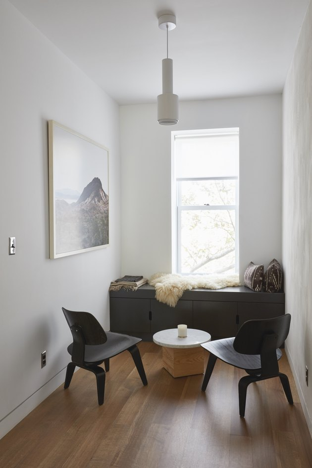 seating area with Eames chairs and built-in bench