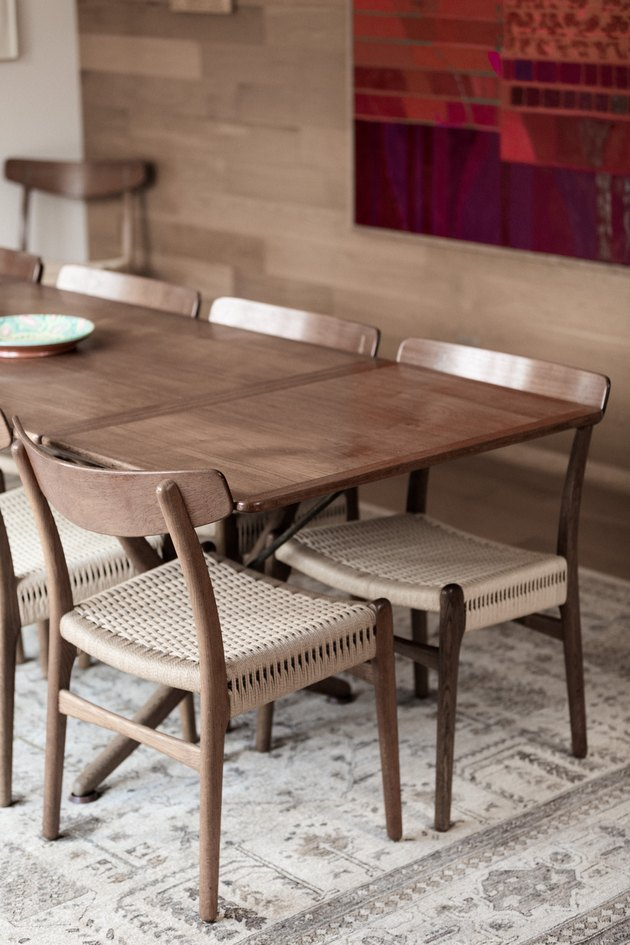 Mid-century dining table compliments the white oak walls.