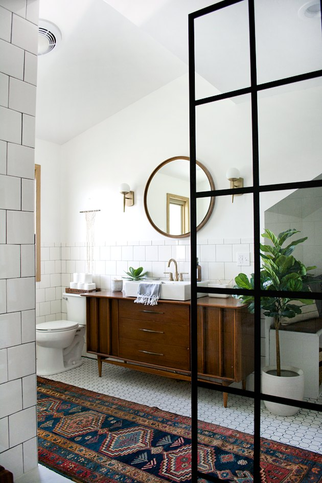 bathroom mirror idea with midcentury bathroom with wooden mirror, persian rug and crittall shower screen