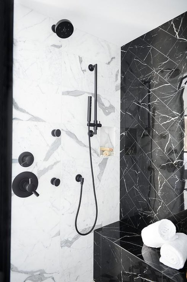 white and black marble shower tile ideas in modern bathroom