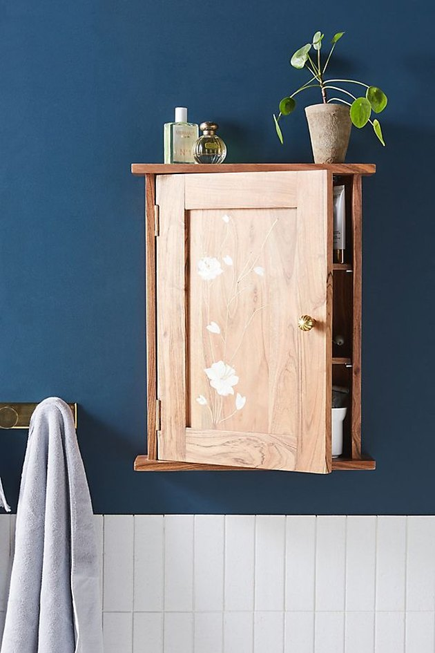 wall mounted bathroom cabinet with floral motif