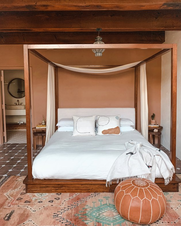 terracotta and clay desert house color palette in bedroom with canopy bed