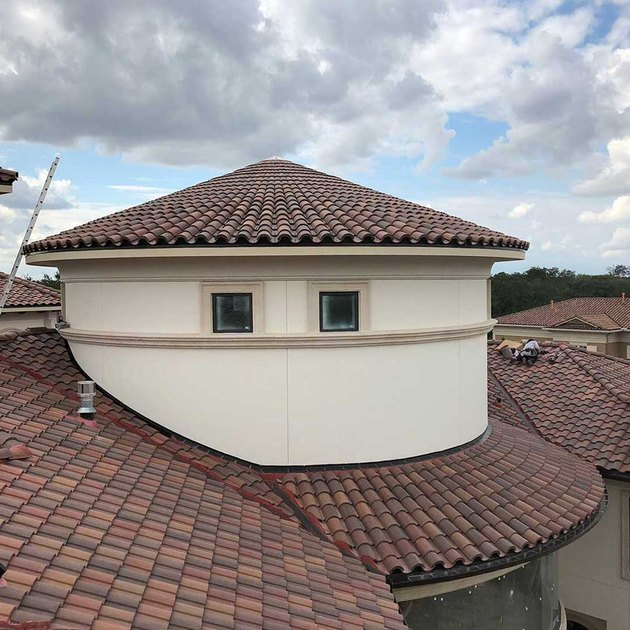 Conical clay tile roof.