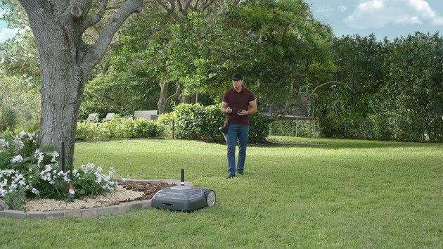 man walking on lawn with Terra robot