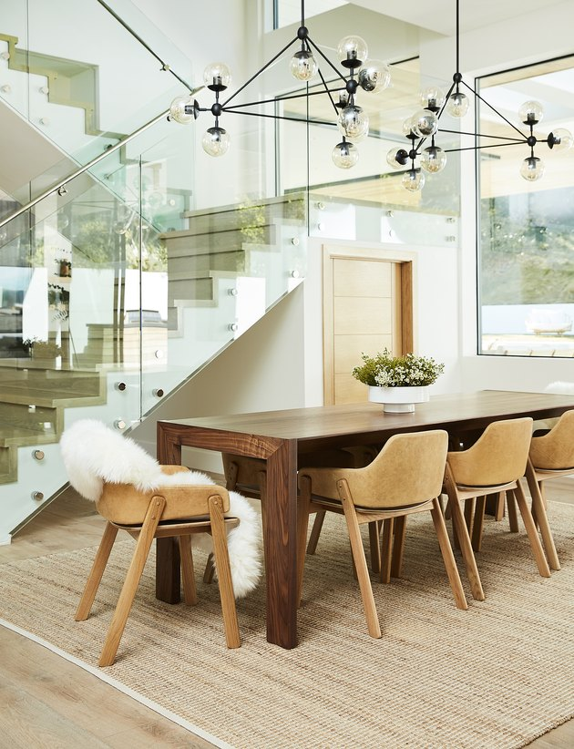 bright dining room with light leather chairs