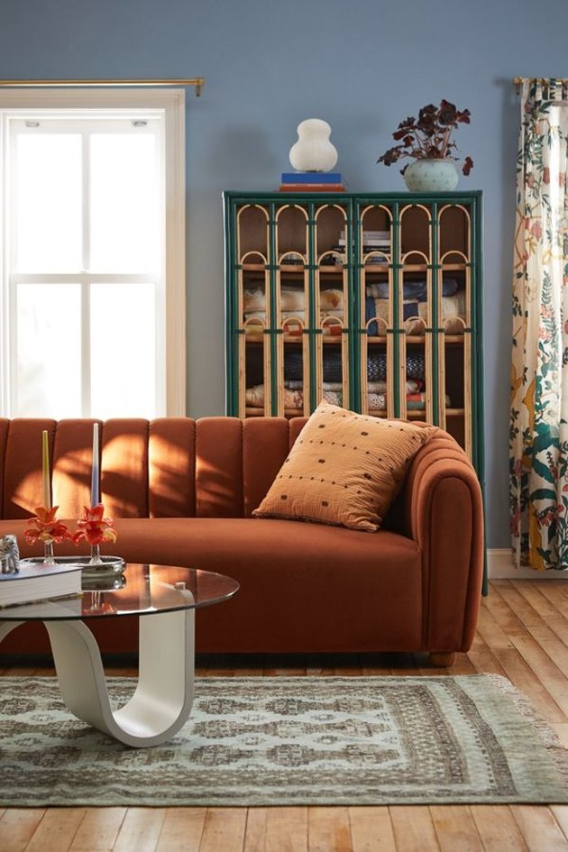 orange sofa in periwinkle living room