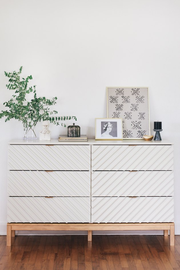 ikea hack featuring Tarva six-drawer dresser turned into a chevron dresser with wooden dowels