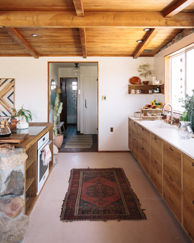 spanish style one wall kitchen with island and wood cabinets