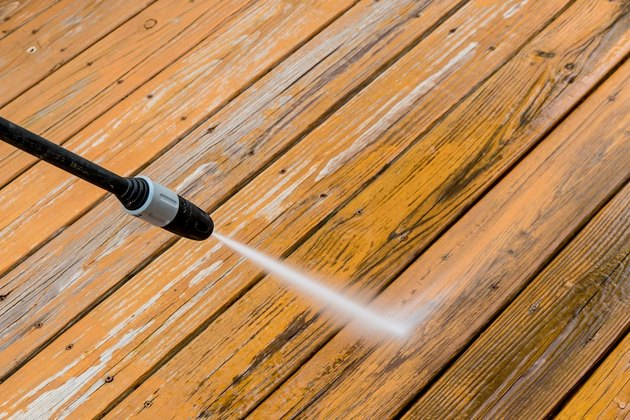 Pressure washing a deck.