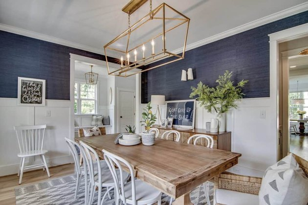 navy coastal dining room with white bentwood chairs and wood dining table
