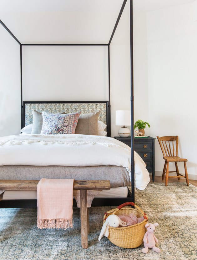 boho girls room with four poster bed with florals
