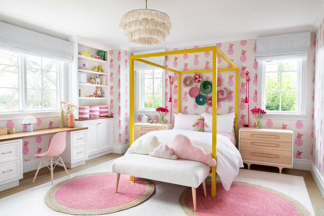 boho girls room with pink pineapple wallpaper