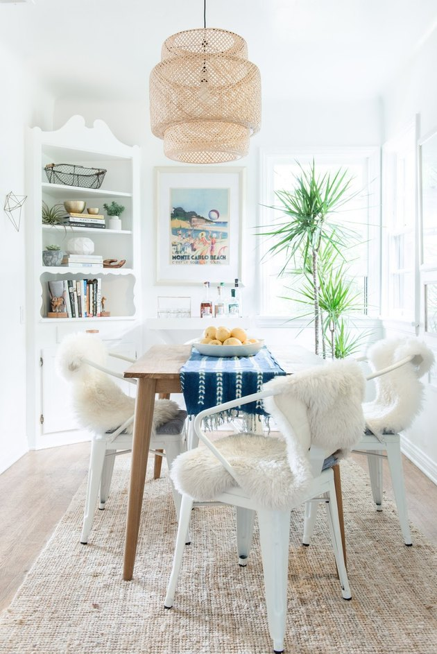 small coastal dining room with ikea pendant and jute rug