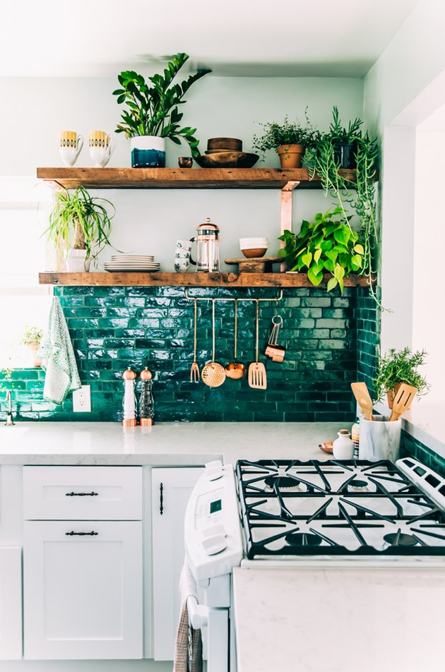 bohemian kitchen with open shelving and green backsplash