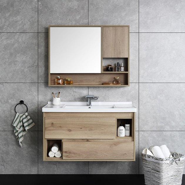 Gray bathroom with wall-mounted Scandinavian bathroom vanity and medicine cabinet