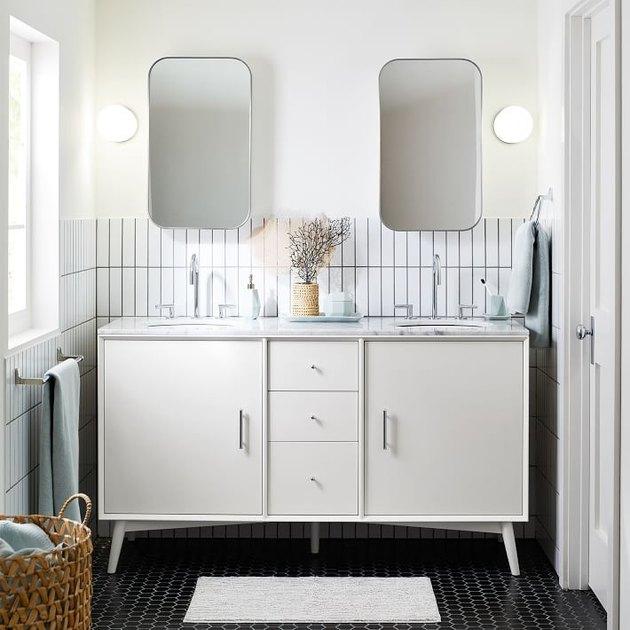 White Scandinavian bathroom vanity with midcentury vanity console