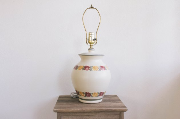 Thrift store lamp with pink and yellow flowers on small table