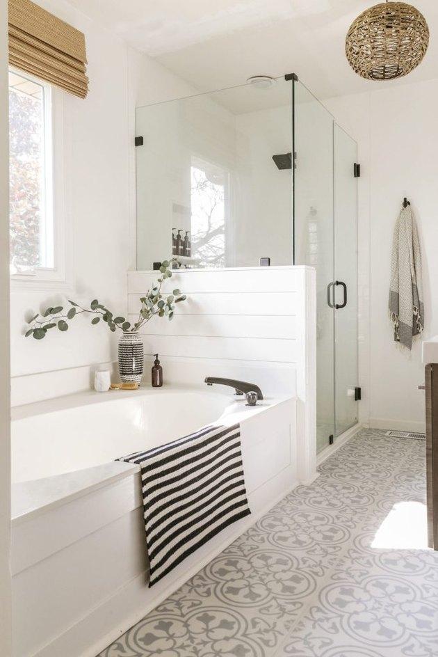 trending bathroom lighting with woven globe chandelier and patterned floor tile