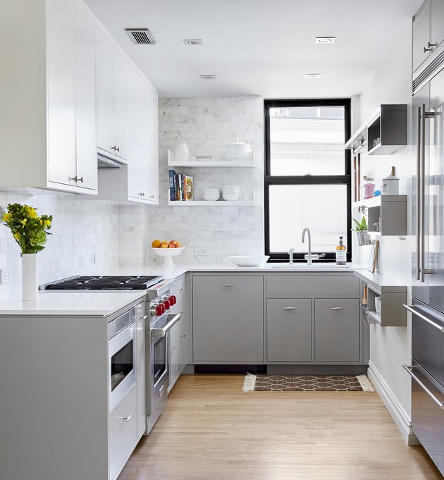 bright modern kitchen with black window frame and white marble