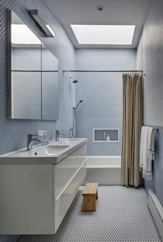 modern bathroom with penny tile and skylight