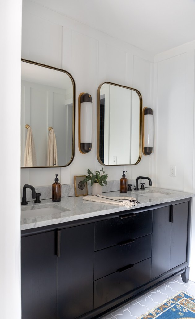 trending bathroom lighting in bathroom with square mirrors and black vanity