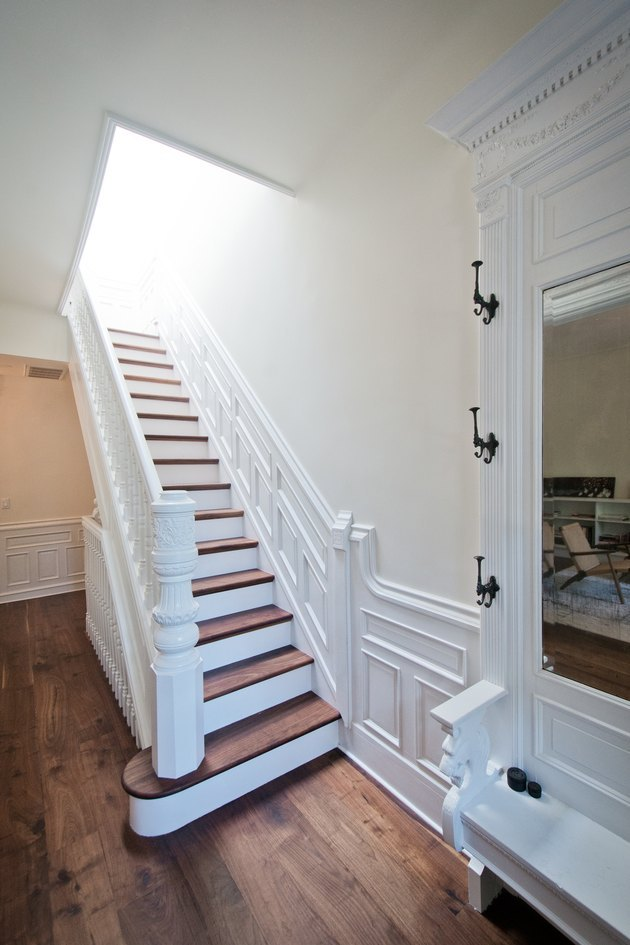 brownstone staircase with skylight and coat hooks entryway