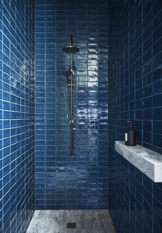 blue shower tile ideas with marble shower ledge