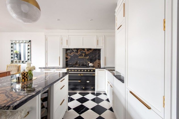 Art deco kitchen with black and white checkered floor and marble backsplash