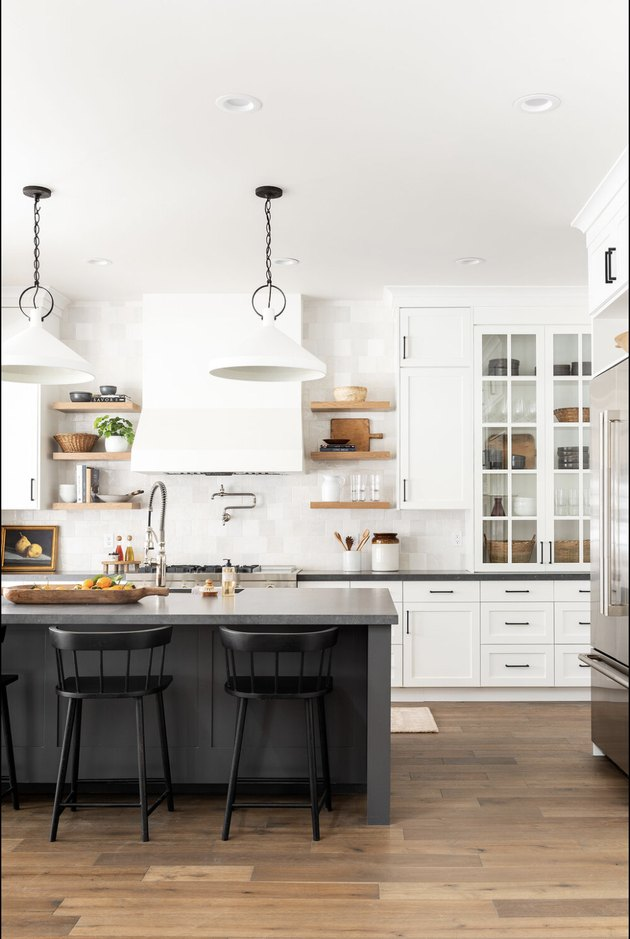 Black kitchen island table in white kitchen