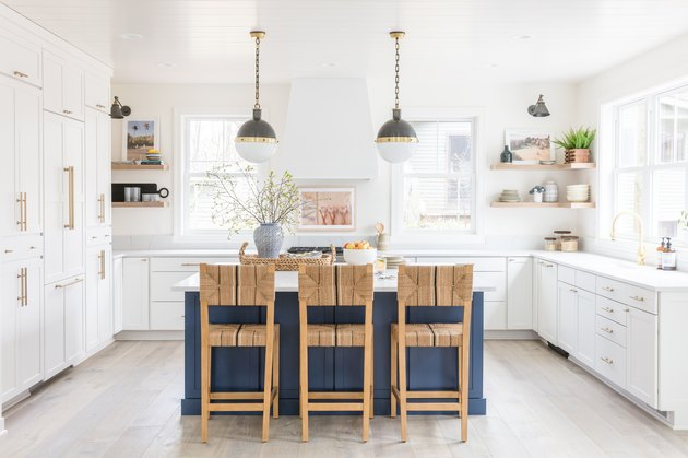 Coastal kitchen island table with woven chairs