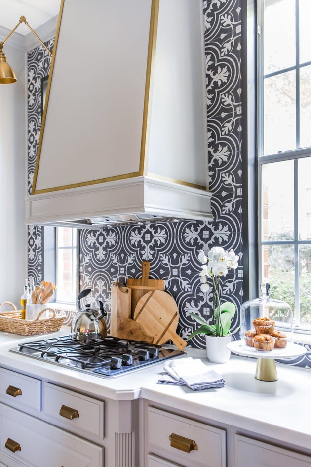 Art deco kitchen with brass accents and art deco tile backsplash