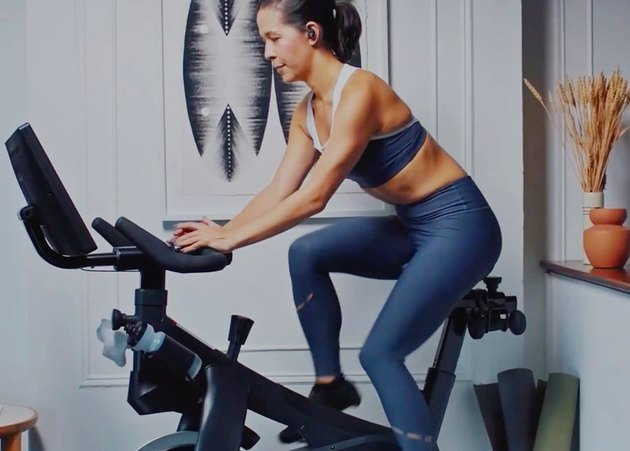 woman on workout bike at home