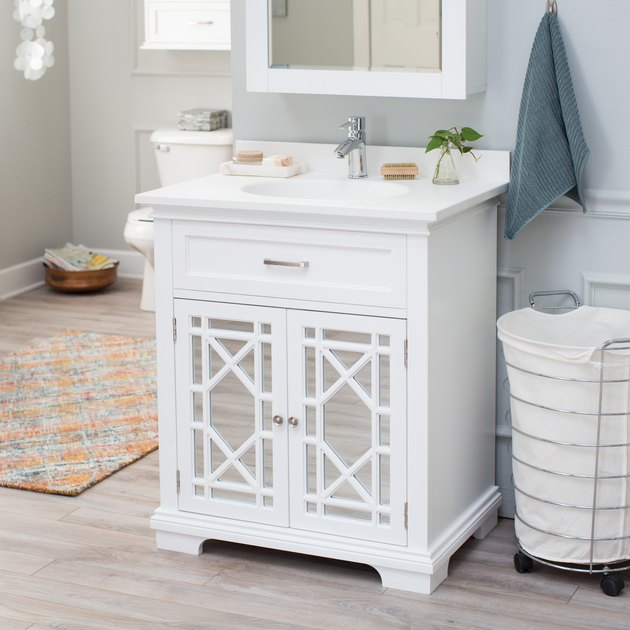 white country bathroom vanity with mirrored doors