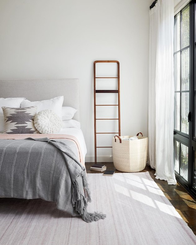 small bedroom organization ideas with basket in corner