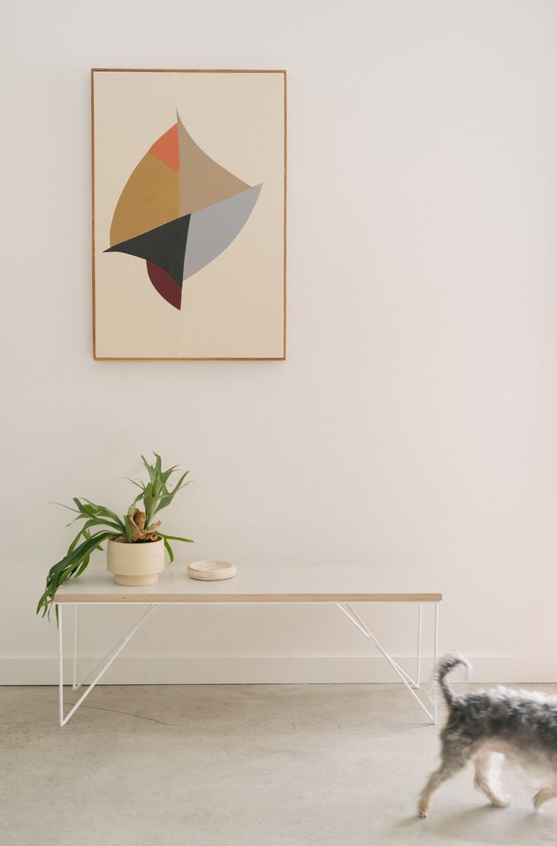 Minimalist entryway design with Hunker rectangular table with plant and ceramic and framed print