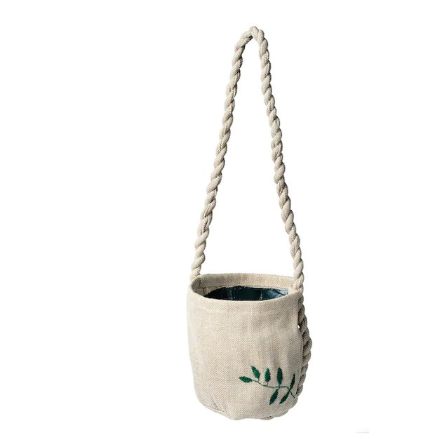 hanging planter with small leaf on it