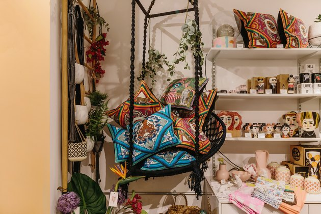 hanging woven chair with silken favours cushions