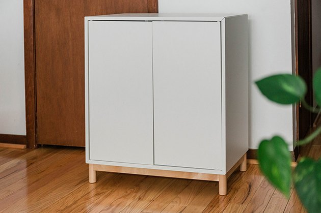 Assemble with you IKEA Eket cabinet using the included instructions.