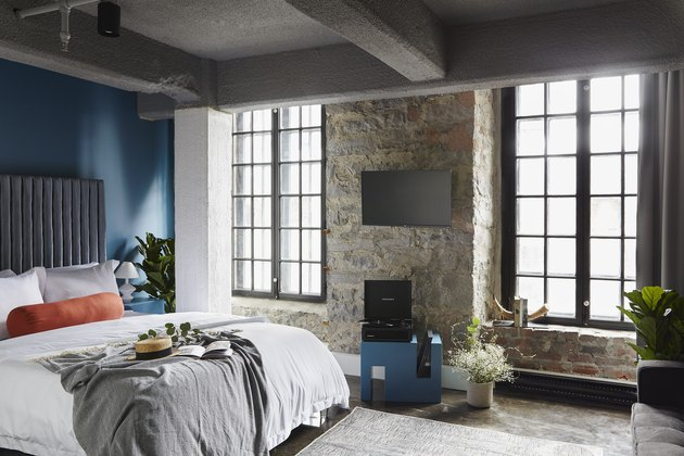 bedroom with stone wall and blue wall