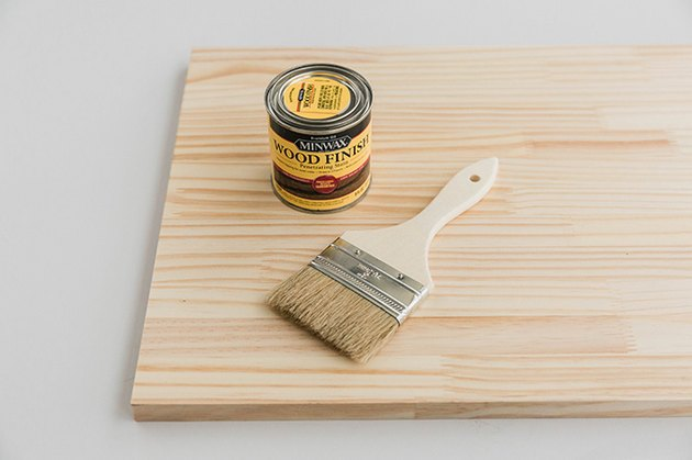 Stain the wood a dark color using a brush.