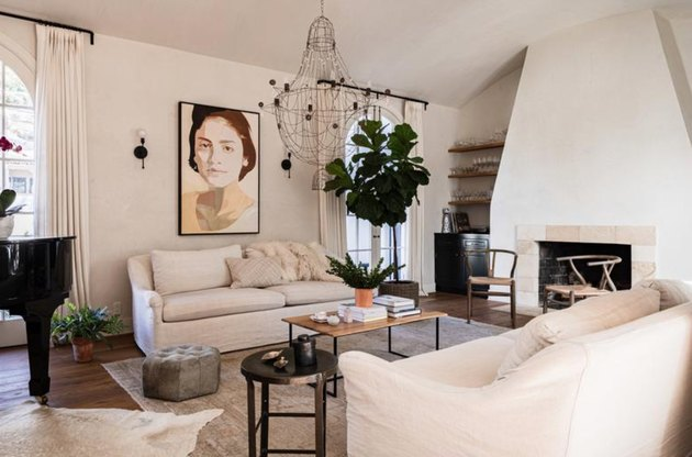 family room furniture with white slipcovered couches and iron chandelier