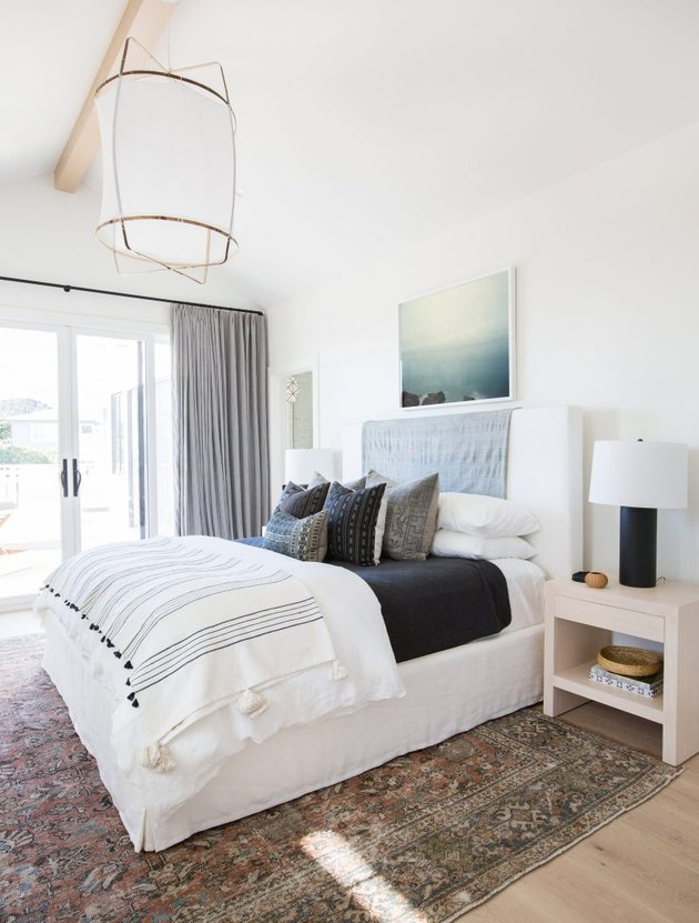 bright white guest bedroom  idea with French doors